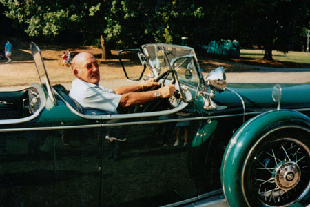 Sir Stirling Moss at the wheel of the V16 Cadillac